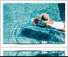 Woman enjoying pool and sun