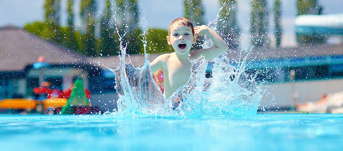 Child plashing water around in a pool