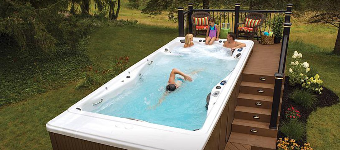 Family sitting in backyard swim spa